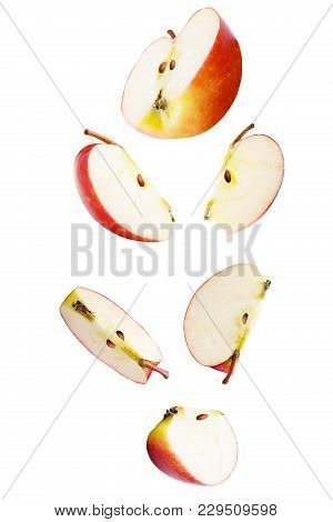 Isolated Falling Fruits. Falling Sliced Apple Fruit Isolated On White Background With Clipping Path