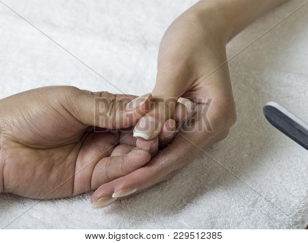 A Close Up Of Female Hands Doing Manicure