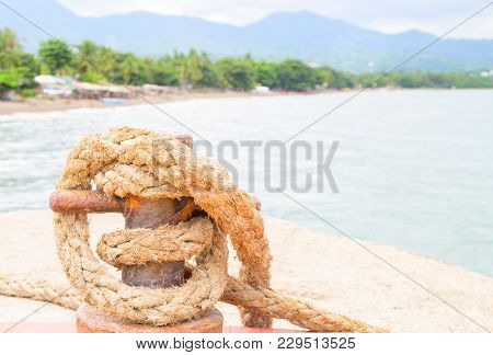 Tropical Seaside Landscape. Pier Rope Holder With Rustic Tackle Closeup. Summer Vacation Travel Conc