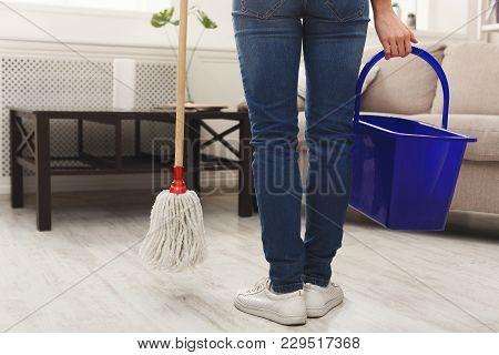 Unrecognizable Woman With Cleaning Equipment Ready To Clean House. Cropped Girl Holding Mop, Profess