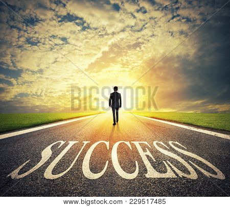 Man Walks On A Big Success Way. Concept Of Successful Businessman And Company Startup