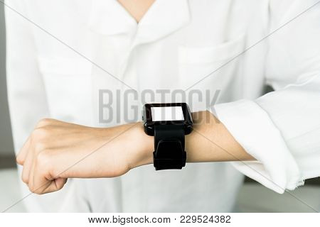 Woman Using A Digital Clock In The Display And Technology Advances In Communication. This Is A New T