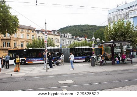 German And Foreigner Travelers People Walking And Wait Tramway And Bus At Heidelberg Old Town Statio