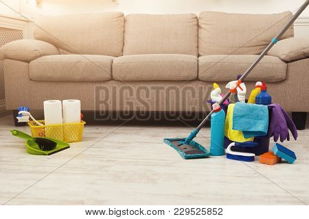 Bucket With Sponges, Chemicals Bottles, Mopping Stick, Rubber Gloves, Brushes, Towel And Scoop. Hous