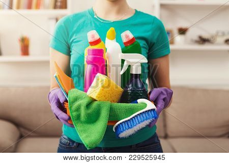 Young Woman Holding Bucket With Group Of Cleaning Supplies For Natural And Environmentally Friendly