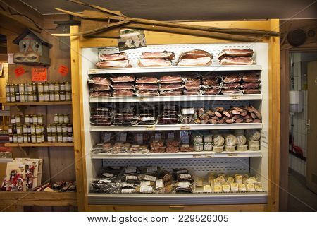 European Sausages And Fish Of Traditional Food Of Germany For Sale Travelers People In Shop At Black