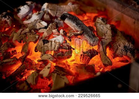 Glowing Hot Charcoal In Bbq Stove. Charcoal Burning Fire In Stove For Cooking Food. Cuisine And Food