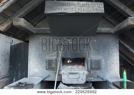 German People Use Firewood Stove Old Style Cooking Bread At Restaurant