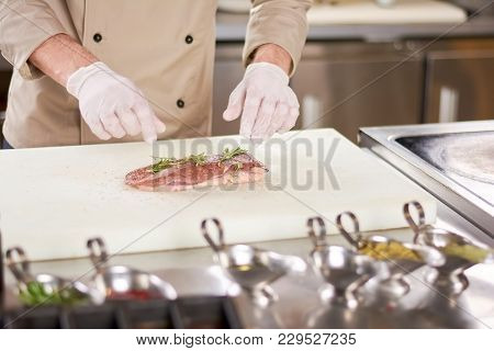 Duck Raw Breast With Rosemary. Raw Fillet Of Duck Breast Served With Rosemary And Ground Pepper. Che