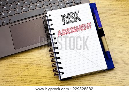 Writing Text Showing Risk Assessment. Business Concept For Safety Danger Analyze Written On Notebook