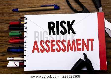 Handwritten Text Showing Risk Assessment. Business Concept For Safety Danger Analyze Written On Note