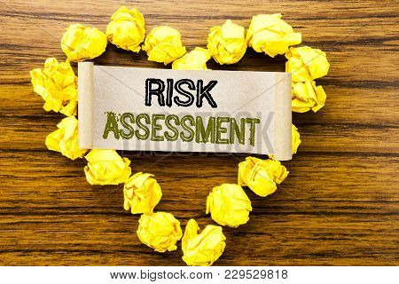 Word, Writing Risk Assessment. Business Concept For Safety Danger Analyze Written On Sticky Note Pap