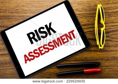 Writing Text Showing Risk Assessment. Business Concept For Safety Danger Analyze Written Tablet Lapt