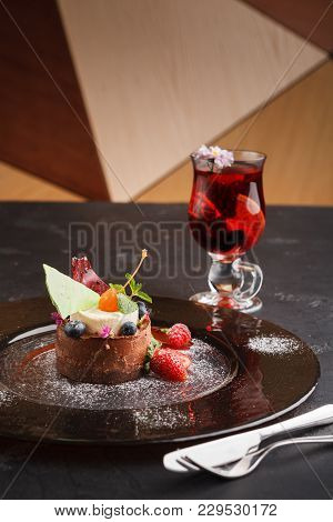 Exquisite Restaurant Mousse Dessert. Chocolate And Vanilla Souffle On Walnut Biscuit Served On Glass