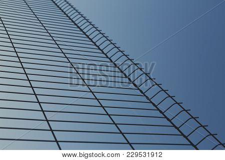 Blue Sky Through Metal Lattice, Bright Creative Urban And Nature Background, Copy Space