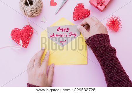 Happy International Women's Day Message On Brown Paper Inside Yellow Letter With Handmade Red Heart,