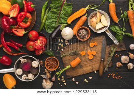 Cooking Ingredients Background. Sliced Carrot And Knife On Cutting Board, Vegetables, Herbs And Spic
