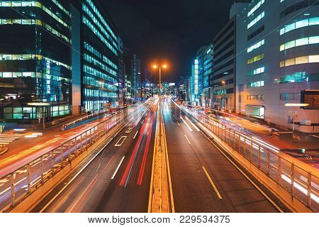 View Of Motion Blurred Traffic In Shibuya, Tokyo, Japan At Night