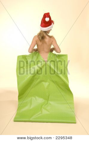 Christmas Woman Popping Out Of Gift Wrap