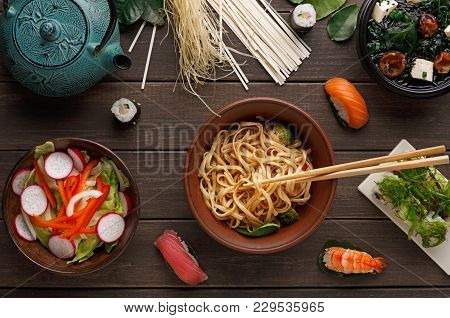 Bowl Of Rice Noodles With Soy Sauce And Chopsticks, Miso Soup With Tofu Cheese, Salad With Onion, Pe