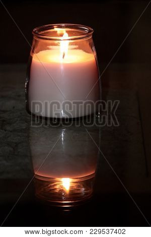 Lighted Candle On A Dark Stormy Night