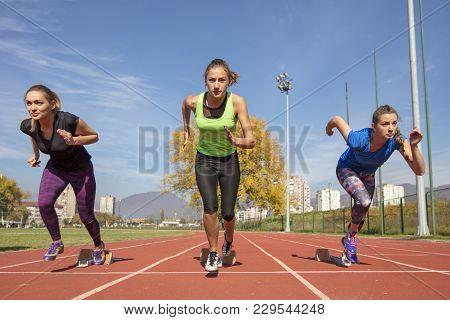 Women Ready To Race On Track Field.
