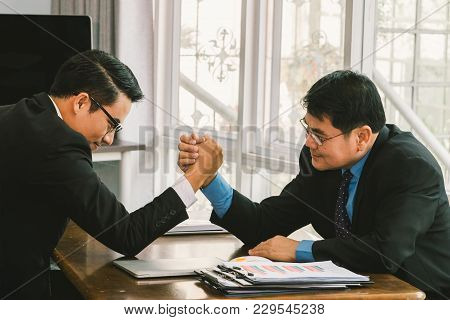 Two Business Men Arm Wrestling , Business Competition Concept