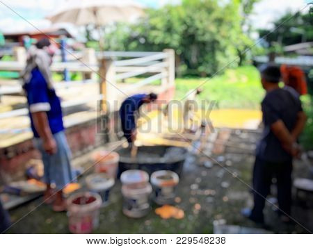 Blurred Image Of Group Asian Laborers Working In The Construction Site For Road Street Repairing And