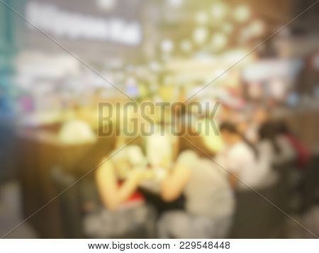 Blurred Image Of People Enjoy Eating In Restaurant Or Cafe After Waiting And Queuing For Order Some