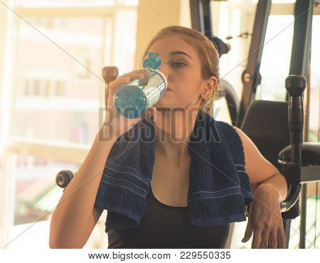 Sport Woman Is Drinking Fresh Water In Fitness Gym