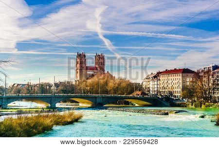 View On Winter Landscape By St. Maximilian Church And Isar In Munich