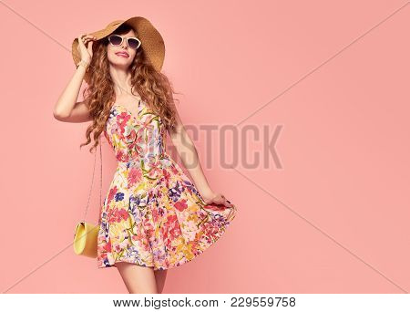 Portrait Of Fashion Young Woman In Floral Dress. Pretty Girl In Hat, Sunglasses. Female Model In Sty
