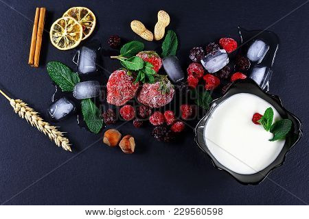 Frozen Raspberry, Strawberries, Yoghurt Plate Mint Leaves, Blackberry, Pieces Of Ice On Shale Board,