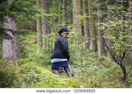 Asian Traveler Thai Old Woman Walking In The Forest At Black Forest Or Schwarzwald At Baden-wurttemb