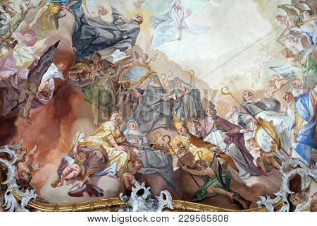 AMORBACH, GERMANY - JULY 08: Last Judgment and Glorification of the Benedictine Order, detail of fresco by Matthaus Gunther in Benedictine monastery church in Amorbach, Germany on July 08, 2017.