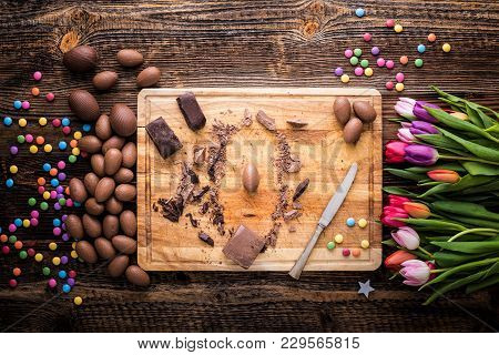 Chocolate Eggs And Raw Pieces Of Chocolate
