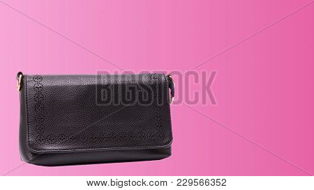Black Leather Clutch On Pink Color Background.