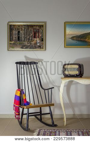 Interior Shot Of Vintage Rocking Chair And Old Radio On Old Style Vintage Table On Background Of Off