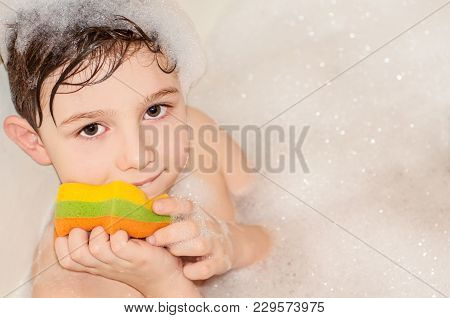 The Boy Himself Washes Himself In The Bathroom With Foam