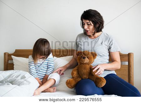 Pregnant mom talking to daughter consolation concept
