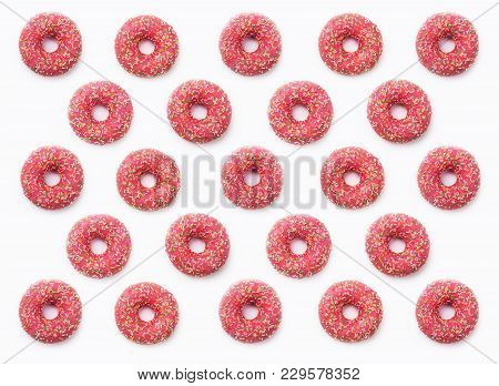 Collage Of Pink Donuts In Glaze On A White Background. Lots Of Donuts Are Mosaic Lined, Delicious Fr