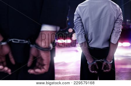 Two Businessman In Handcuffs On The Streets