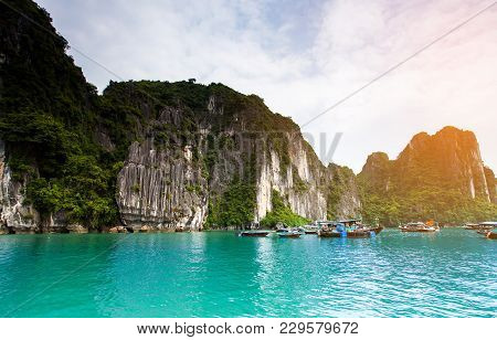 Floating Fishing Village And Rock Island In Halong Bay, Vietnam, Southeast Asia.