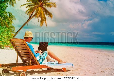 Man With Laptop On Tropical Beach Vacation, Remote Work Concept