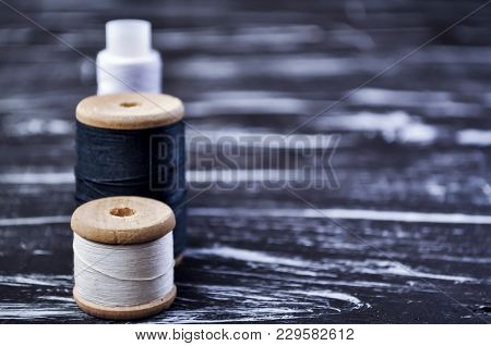 The Spool Of Thread On The Table.