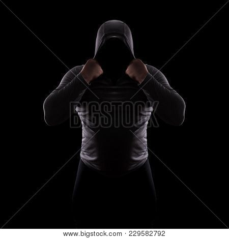 Silhouette Of A Male Fight Club In A Hood Without A Face. Stalker Silhouette On Black Background, In