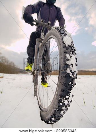 Front Bike Detail On A Winter Trail, Path Covered By Snow. Sportive Backgrounds And Still-life. Biki