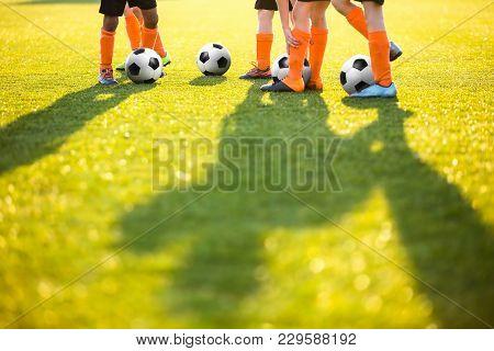 Boys Training Football On The Pitch. Soccer Football Training Session For Kids. Soccer Pitch On A Su