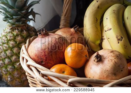 Detail Shot Of A Basket Full Of Fruits, In The Picture We Can See Pomegranates, Oranges, Clementines