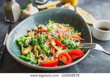 Vegetarian Salad With Mushroom, Cheese, Lettuce And Pepper In A Plate. Closeup View
